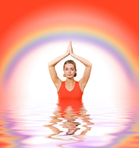 Beautiful girl meditating in water